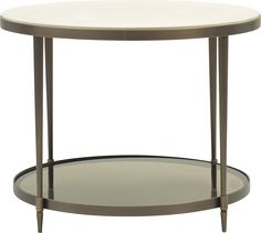 Inspired by the beauty of a cultured pearl, the Oberon Side Table is the perfect round occasional table. The resin top swells down as if scooped out of a solid block.
