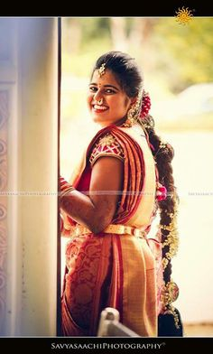 Traditional South Indian bride wearing bridal saree and jewellery. #hairstyle