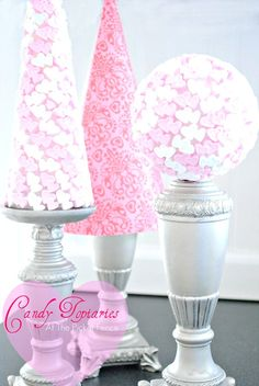 candies,hearts...topiaries. Good be a cute centerpiece Idea! Edible for guests :)