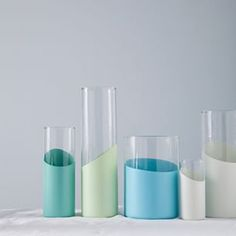 Simple and beautiful glass vases with Montana GOLD spray painted accents in cool pastel colors