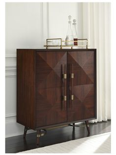 i like the tall, closed cabinet for a bar cabinet, but this exact style might not work.