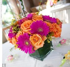 Roses daisies centerpices | The centerpieces were vibrant combinations of hot pink gerbera daisies ...