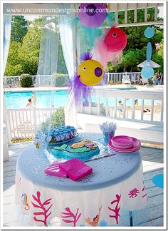 I must try this for Trinis bday party! Under the Sea and Magical Mermaid Simple Birthday Party - Uncommon Designs. Lila Party, Festa Party, Little Mermaid Parties, 3rd Birthday Parties, Birthday Ideas, Birthday Table, 2nd Birthday, Mermaid Birthday, Fish Lanterns