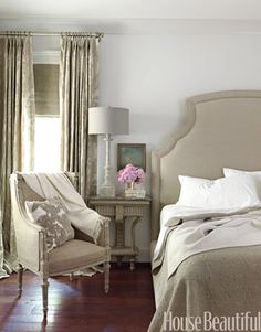 In a formal Alabama home by Tracery Interiors, patterns and textures give a greige bedroom subtle richness. Walls are Benjamin Moore's Revere Pewter. The Bernhardt bed in natural linen is from Three Sheets. Throw pillow from Ankasa.