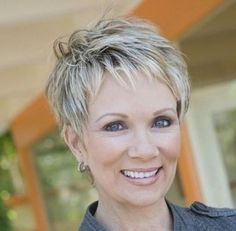 A short blonde straight coloured multi,tonal choppy mature Womens haircut  office hairstyle by Mature Web Collection
