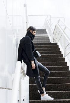 Turtleneck Fashion Trend: Melissa Araujo is wearing a black turtleneck from Zara