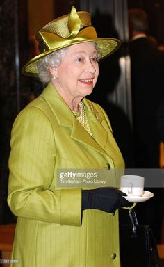 Queen Elizabeth II Drinking Tea During Her Visit To The Newly Refurbished Ministry Of Defence Building In Whitehall, London.