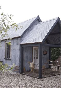 Love this little building with corrugated sheet metal exterior!  It would make an adorable guest house.