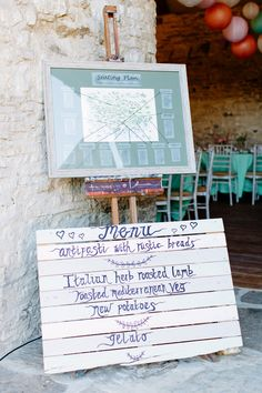 Map table plan and wooden pallet Menu board - Image by Camilla Arnhold Photography - Dorset rustic barn wedding with a pink peach and mint colour scheme, a vintage ice cream bicycle and Italian influences