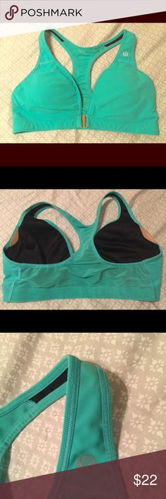 Lululemon Sports Bra Only worn and washed a handful of times, tag is ripped out, but I believe it's a size 6 (possibly a 4). Comes with pads, has front clasp. lululemon athletica Intimates & Sleepwear Bras