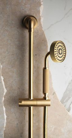 #DailyProductPick The Bauhaus-inspired LMK Industrial shower handset and riser rail in brass by Samuel Heath displays an elegant combination of textures and finishes.