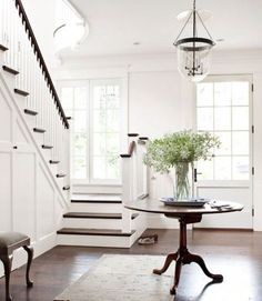 Lovely entry with white woodwork, dark timber floors and stairs