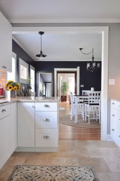 Love the color of the dining room, the kitchen cabinets, tile and molding. Beth's New-Meets-Old Beach Cottage Inspired Bungalow House Tour Home Design Decor, House Design, Interior Design, Home Decor, Kitchen Paint, Kitchen Design, Kitchen Walls, Kitchen Layout, Kitchen Flooring