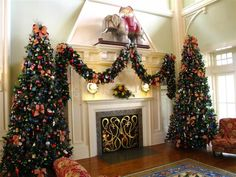 [Decoration] : Beautiful Christmas Decorating For Living Room With Two Christmas Tree With Colourful Accessories Plus Light Installation Available Fireplace With Mantels Along With Wall Lamp Brown Wooden Floor And Red Floral Sofa Set Synthetic Rug