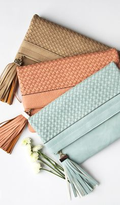 We're in love with these amazing pastel clutches. A wardrobe essential that can take your wardrobe style from day to night. The fringe accent is a fun detail that sets these handbags apart from the classic clutch.
