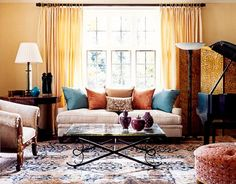 An antique Persian Malayer rug was inspiration for this blue-and-rust palette in this living room.