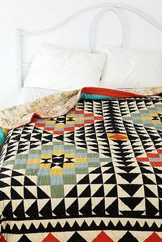 kaleidoscope patchword quilt - urban outfitters  geometric vase (trend spotting - graphic patterns and geometric designs, home decor ideas and trends)