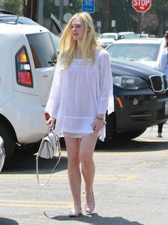 Elle Fanning Photos Photos - 'Maleficent'' actress Elle Fanning meets up with her parents Steven and Heather to enjoy brunch together on June 6, 2014 in Los Angeles, California. Elle recently spoke about working with Angelina Jolie saying,