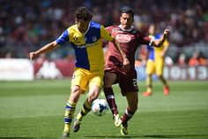 Giuseppe Vives (R) of Torino FC competes with Marco Parolo of Parma FC during the Serie A match between Torino FC and Parma FC at Stadio Oli...