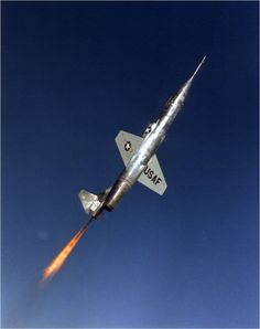 One of the three Lockheed NF-104A Starfighter Aerospace Trainers, 56-756, in a zoom-climb with the rocket engine firing. (U.S. Air Force)
