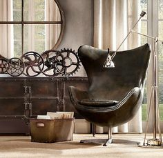 industrial chic ....all about mirrors & windows & gears....& one fabulous chair in which to ponder it all.....