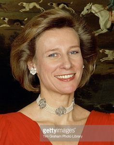 HRH the Duchess of Gloucester wearing a pearl choker with diamond quatrefoils. She's also wearing a pair of diamond floral earrings.