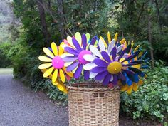 Happy Daisies are plastic garden ornaments that spin in the wind and have been available since Garden Ornaments, Daisies, Spin, Different Colors, Basket, Colours, Happy, Plants, Blog