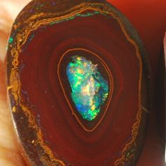 Rare Yowah Nut Opal with green crystal center.