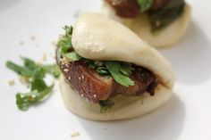 True Taiwanese pork belly buns have five defining components: the fluffy steamed bun, tender braised pork belly, pickled mustard greens, fresh cilantro, and powdered peanuts. All combined, it's a messy, colorful, glorious snack of salty, sweet, pungent, and fresh flavors, with multiple textures to boot.