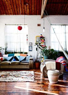 Sarah Nolan's gorgeous inner city boho warehouse home. Quirky prints, rustic timber, white wash and eclectic