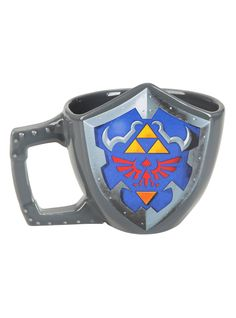 Ceramic mug from Nintendo's The Legend Of Zelda with a sculpted Hylian Shield design.