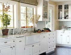 {shell seaglass}: {a bungalow kitchen} Though we would not do the marble - a very light granite would work. Again, a bevel in the cabinets. The cool floor is nice too, also achievable with tile.