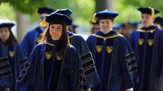 Notre Dame University ~ Students receiving doctoral degrees wear royal blue robes and tams.