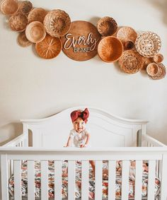 I redid the basket wall 🧺 in Everly's room and I'm honestly loving how it turned out 😍 Almost as much as she's loving the fact that she was… Boho Nursery, Baby Nursery Decor, Baby Bedroom, Nursery Neutral, Nursery Themes, Nursery Room, Nursery Design, Girl Nursery Art, Nursery Ideas