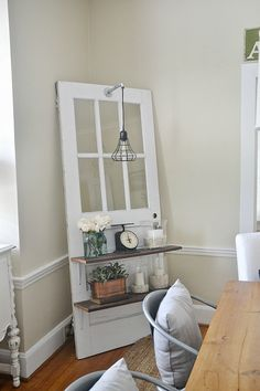 Lovely rustic neutral dining room - A great pin for dining room decor ideas! Lovely door shelf with a light in the corner.