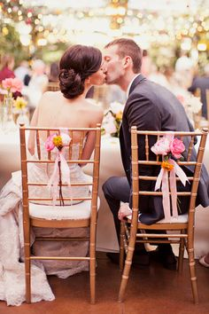 like the chair decor - simple floral with ribbons too! :)