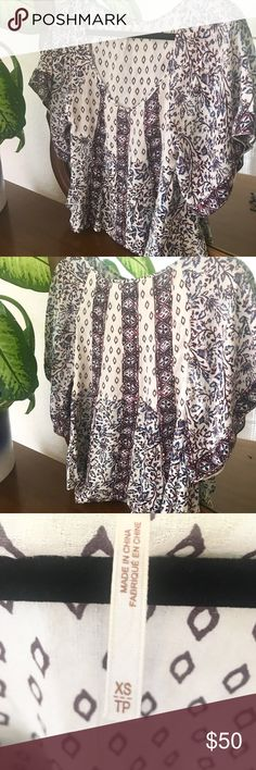 Free People flowy bohemian top Adorable fun flowy boho top from Free people. Cream colored with burgundy and navy color in the print. The top is super soft and comfortable to wear. 100% rayon Free People Tops Blouses