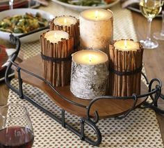 Sleigh Tray | Pottery Barn. (DIY idea:  How simple is it to wrap a candle with cinnamon sticks and twine or leather lacing???)