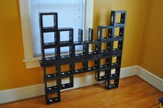 upcycled VHS tapes made into a bookshelf... and I threw all my old tapes away...