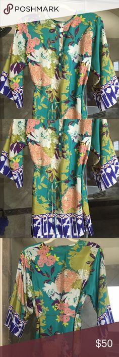 CAbi Floral Print Silk Tunic Excellent condition. Looks great with white skinny jeans. Runs large as I usually wear a medium. CAbi Tops Tunics