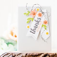 Tags are the focal point in this clean and simple thank you card.