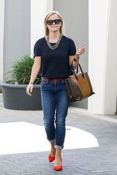 Reese Witherspoon. W Bag, Louis Vuitton.