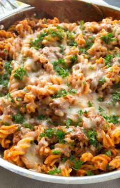 This all-in-one beef ziti is made entirely in the skillet and whips up in 30 minutes flat! Your family will love how hot and cheesy it is. | wholeandheavenlyoven.com