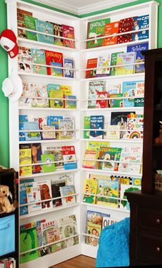 Corner full of books in a nursery...this would be perfect in a playroom, too!