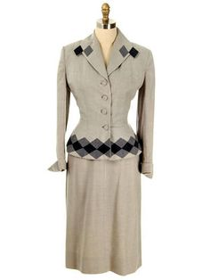 1940 Soft Grey Wool Gabardine Peplum Suit with Contrasting Heather and Charcoal Gray Harlequin Diamond Appliqué Detailing at Hem and Collar by Lilli Ann.