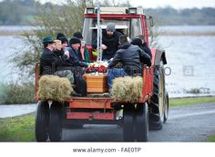 Longford, Ireland. 28th December, 2015. Remains of Johnny Clarke being transported to Saints Island Graveyard, Co Longford following his funeral mass. Recent flooding in the area means that Saints Island can only be reached by tractor. © James Flynn/APX/Alamy Live News