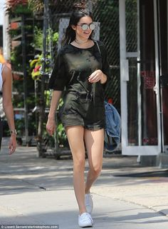Legs for days: Kendall Jenner flaunted her model legs in a very short camouflage style dress and a long denim jacket