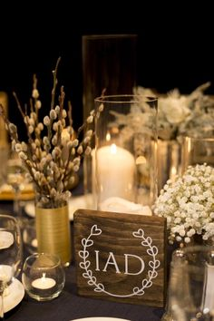 mix of small grouped arrangements in babies breath, pussy willow surrounded by candlelight: Bridal Bliss Wedding