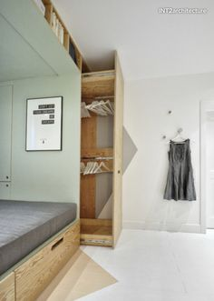 A Cozy And Stylish Bedroom With A Multifunctional Built-In Bed And Storage Area…