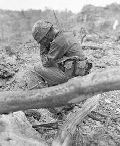A US Marine weeps after killing a Japanese soldier, Battle of Peleliu Island, WW2